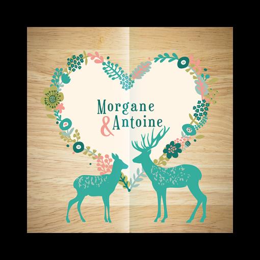 Faire-part de mariage montagnard, couronne de fleurs illustrées, vert mint et fond bois. Cerf et biche.