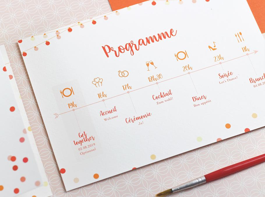 Programme mariage sous forme de schéma avec confettis orange et rouge