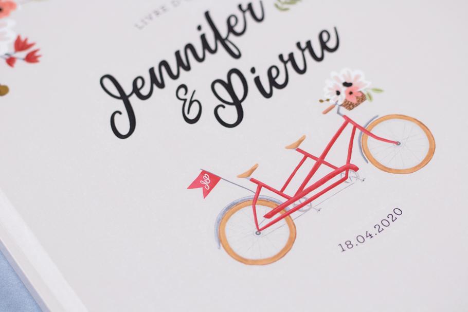 livre d'or mariage tandem, vélo rouge avec drapeau